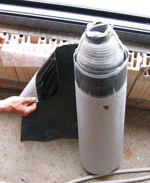 revêtement d'un toit plat par une membrane plastomère